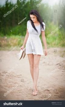 Attractive Brunette Girl Short White Dress Stock