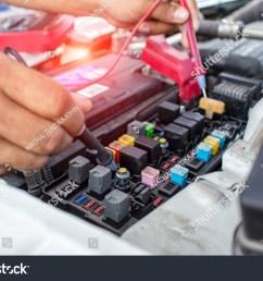 auto mechanic use digital multimeter pen check fuse  [ 1500 x 1101 Pixel ]