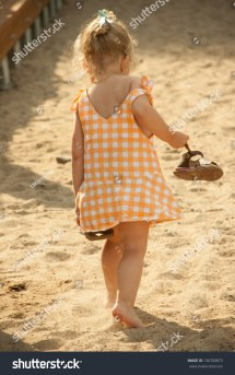 View Of Cute Barefoot Baby Girl Walking Beach With