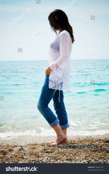Woman Standing Barefoot Jeans