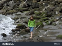 Girl Walking Barefoot On Rocks