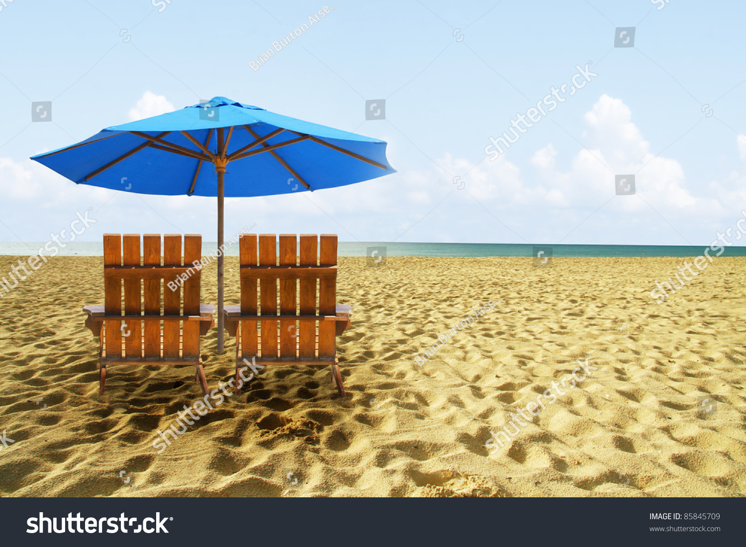 perfect beach chairs yellow swivel chair on tropical golden sand stock