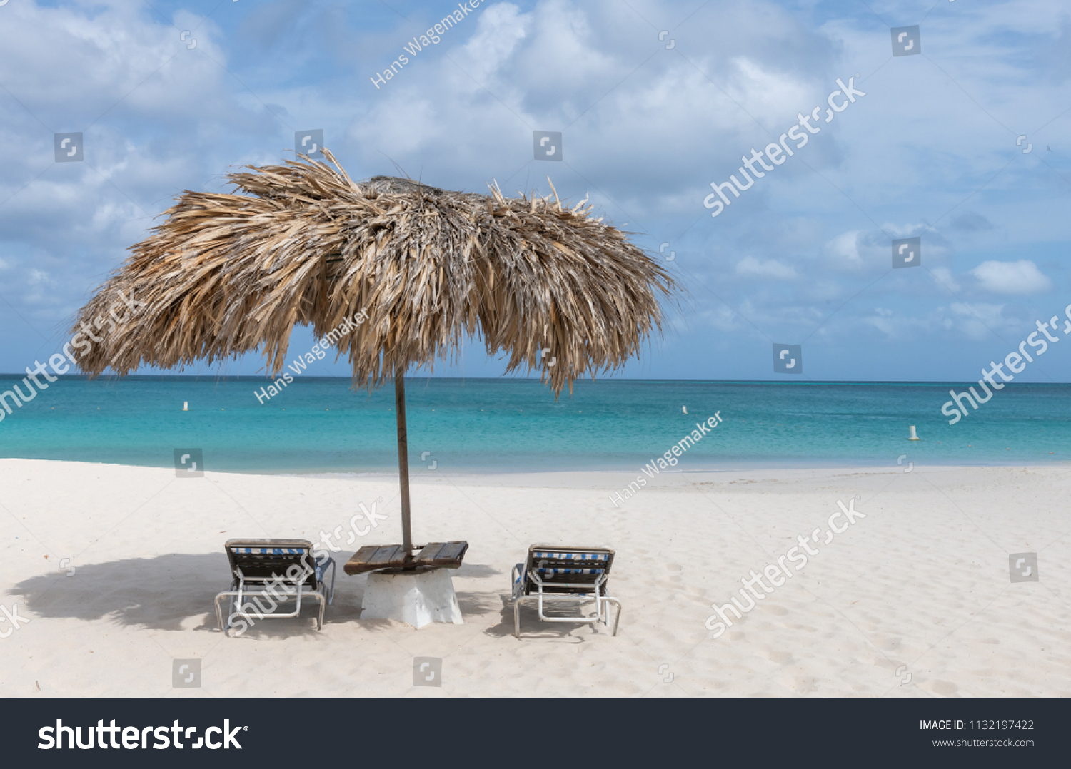 Beach Lounge Chairs Beach Lounge Chairs Under Thatched Umbrella Stock Photo Edit Now