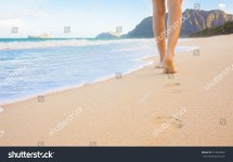 Feet Walking On the Beach Sand