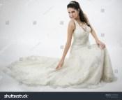 Wedding Bride in Dress Sitting Down