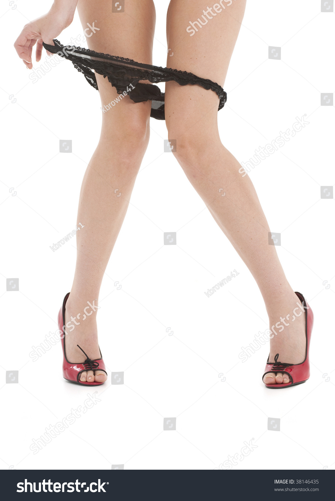 Beautiful Female Legs With Panties Being Playfully Pulled Down Against A White Background Stock Photo 38146435 : Shutterstock