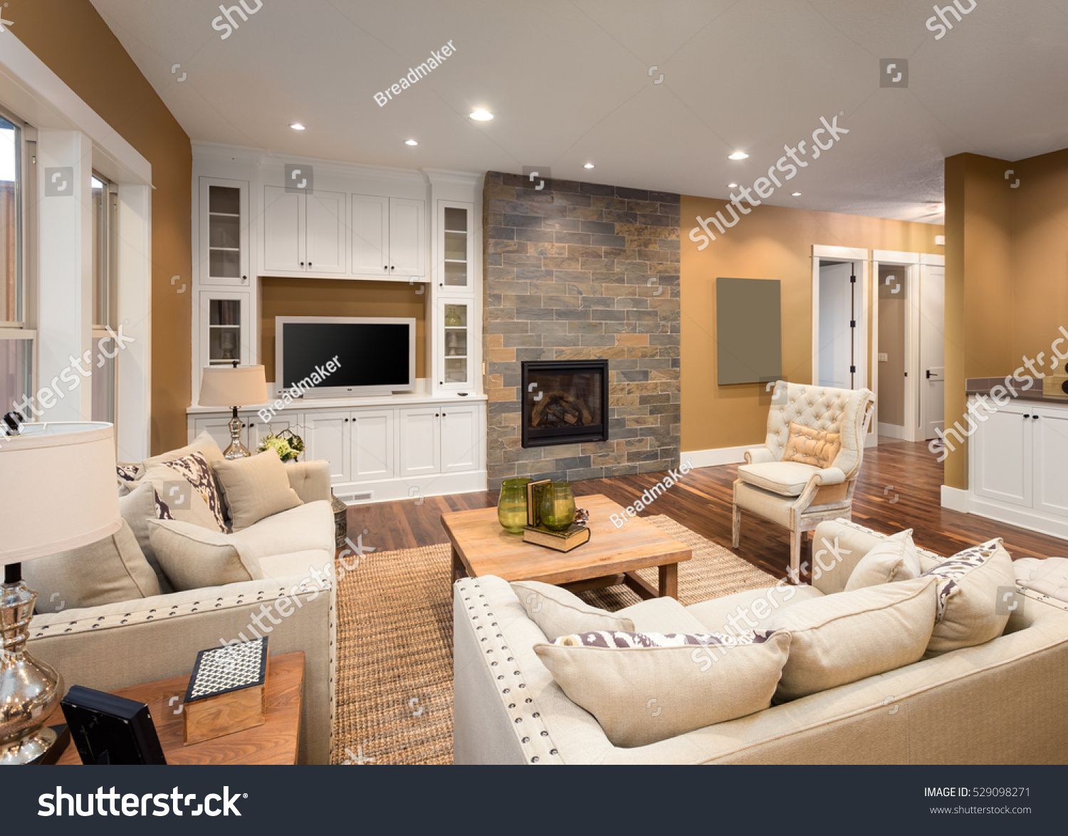 pictures of furnished living rooms room paint color ideas beautiful fireplace television stock photo with and in new luxury home hardwood floors