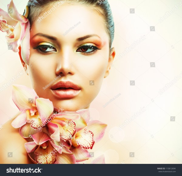 Beautiful Girl With Orchid Flowers.beauty Woman Face.vogue Styled Fashion Portrait. Professional