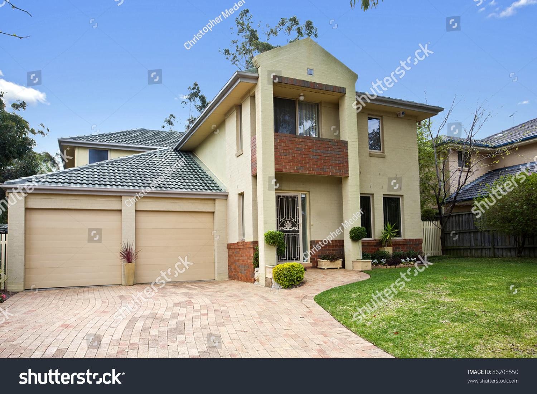 Beautiful House Against Vibrant Blue Sky Stock Photo