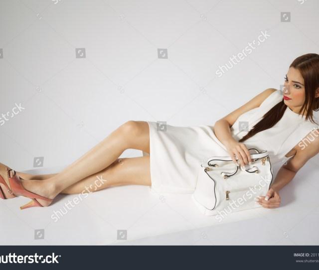 Beautiful Indian Fashion Model Sitting On The Floor And Posing Indian Fashion Model Wearing White