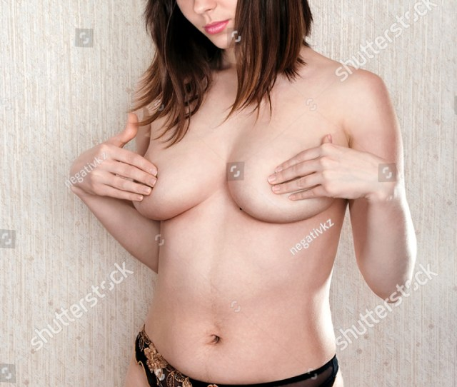 Beautiful Naked Girl Covered With Hands A Breast