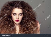 beauty young woman curly small