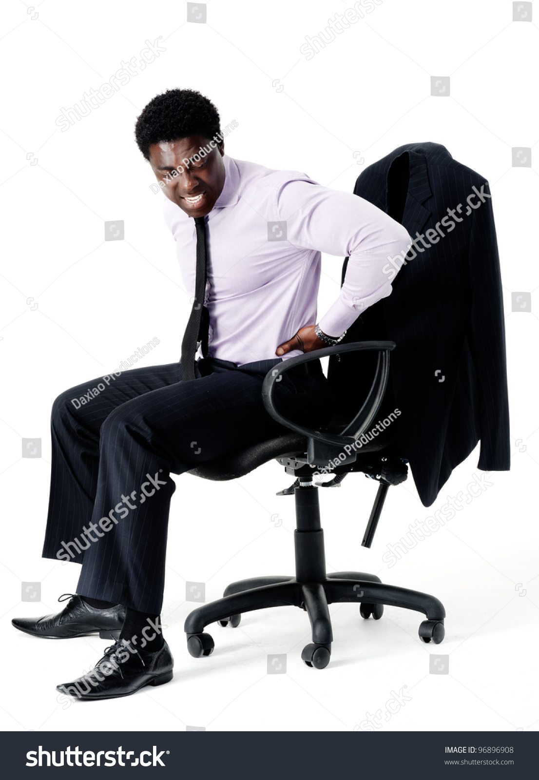 sitting posture on chair in office modern furniture chairs designs black businessman pain from his