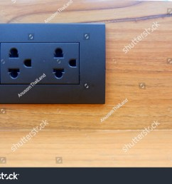 black electrical plugs attached to wooden walls home electricity design of electrical wiring in the house  [ 1500 x 1101 Pixel ]