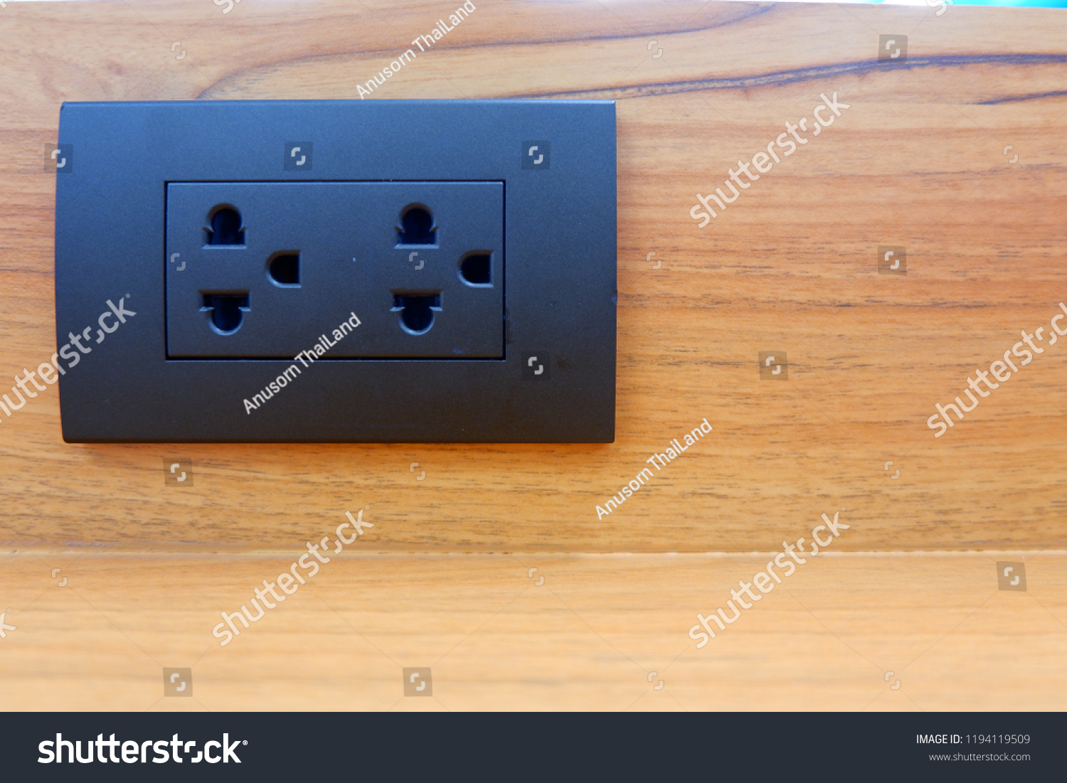 hight resolution of black electrical plugs attached to wooden walls home electricity design of electrical wiring in the house