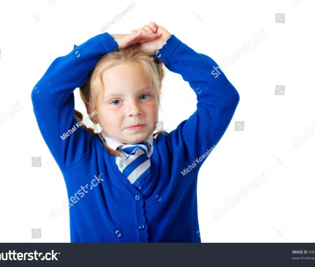 Blonde Schoolgirl In Blue Dress And Pigtails Shoot Over White Background