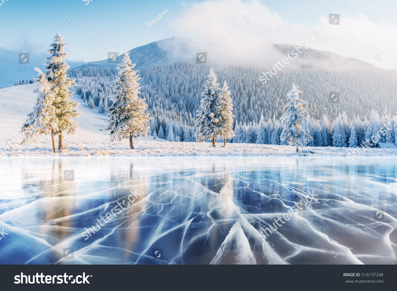 Blue Ice Cracks On Surface Ice Foto Darchivio 516137248  Shutterstock