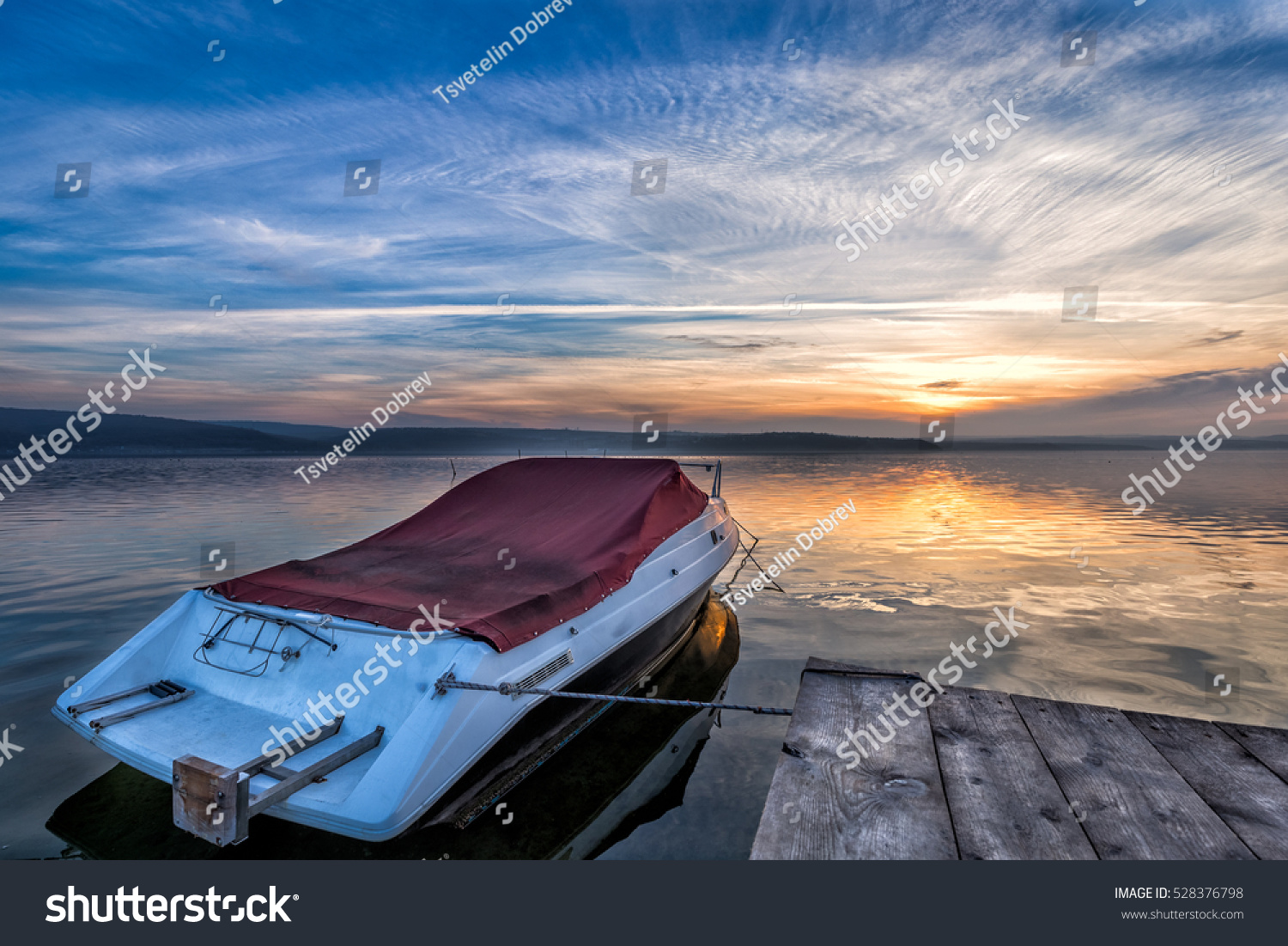 Boat Near To A Pier At Sunset Time Stock Photo 528376798
