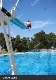 Boy Jumping High Diving Board Stock 58023055