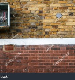 bricks wall with electricity fuse box on it opened cover missing cables  [ 1500 x 1101 Pixel ]