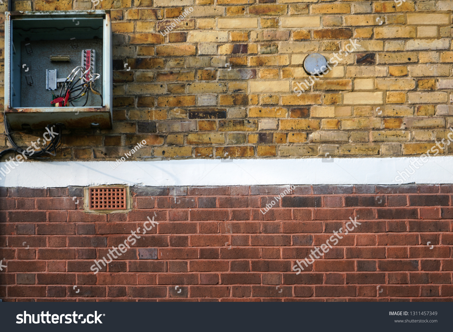 hight resolution of bricks wall with electricity fuse box on it opened cover missing cables