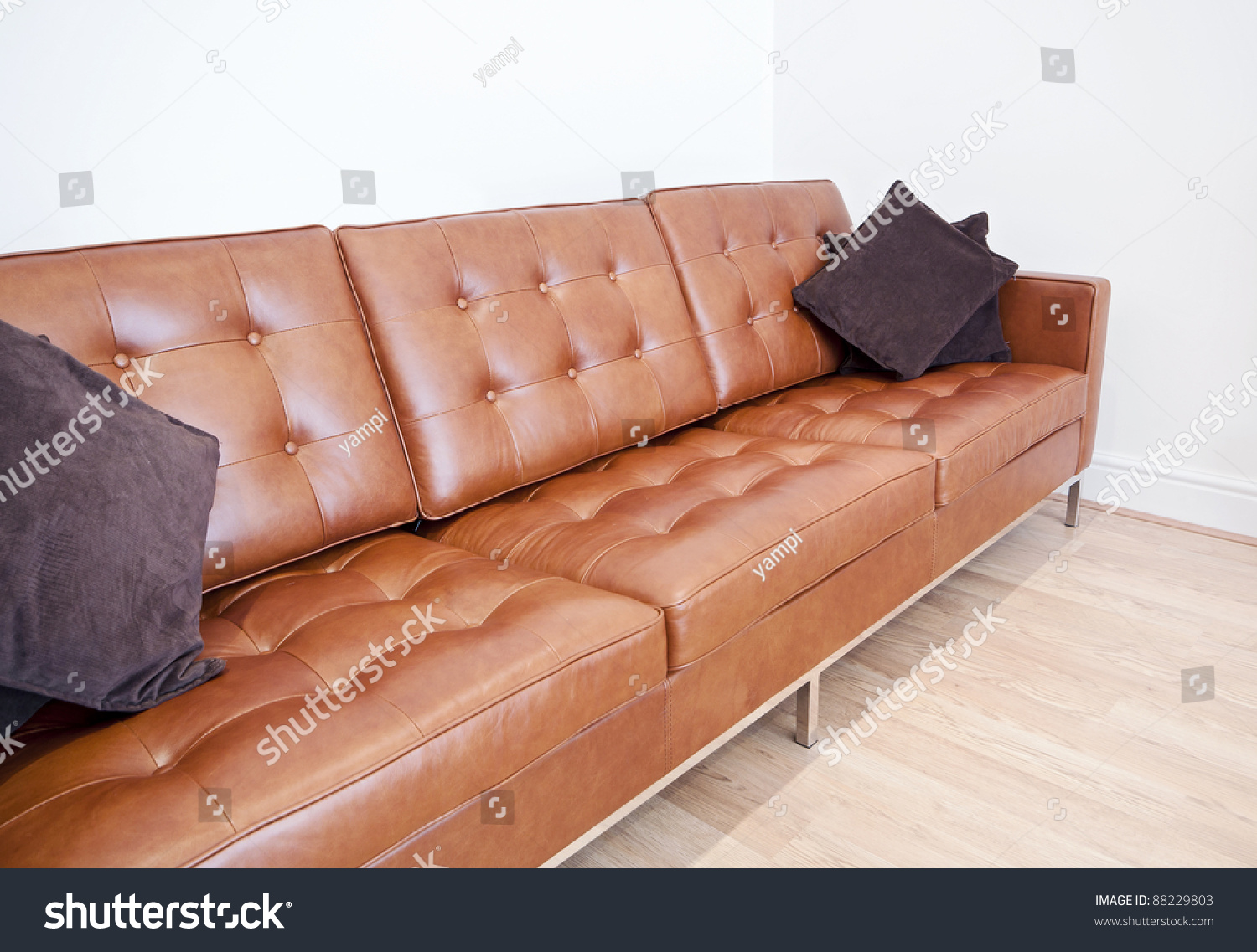 brown leather sofa on legs pink corner uk chromed and with cushions stock