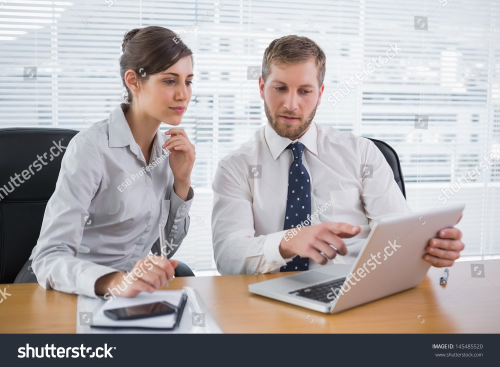 medium resolution of business people working together on laptop stock photo