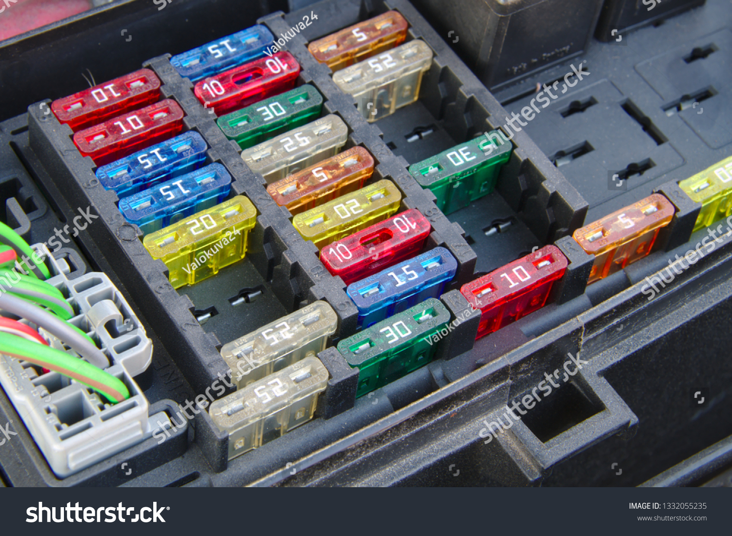 hight resolution of car fuse box closeup multiple rows of different fuses one connector and part of