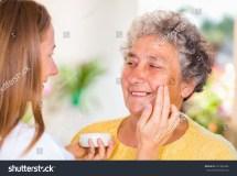 Caregiver Rubs Face Cream Elderly Stock 231485284