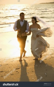 Caucasian Mid-adult Bride And Groom Holding