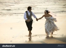 Caucasian Prime Adult Male Groom And Female Bride Running