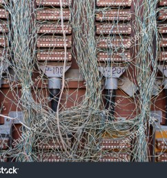 chaos of wires telephone cable junction box risk of fire  [ 1500 x 1101 Pixel ]