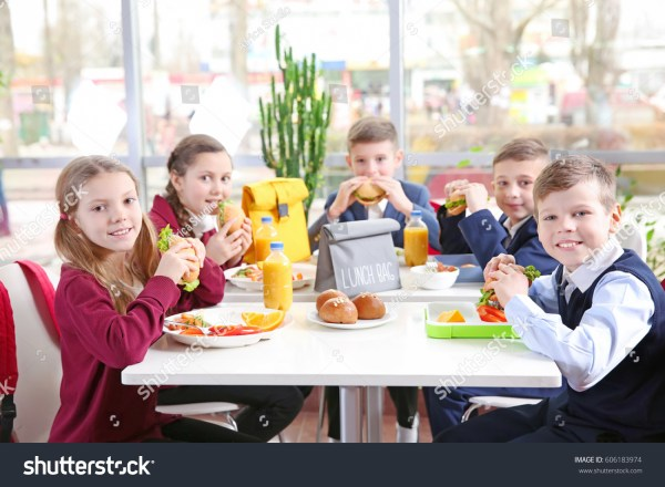 Children Sitting at Table Eating