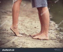 Close- Of Barefoot Pair Human' Feet Sandy Beach