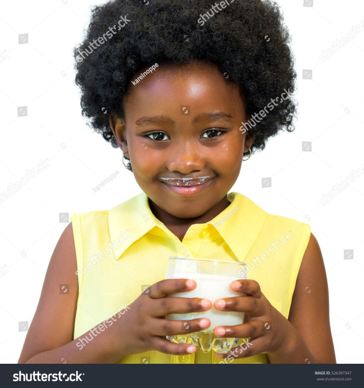 Close Portrait Little Black Girl Holding Stock