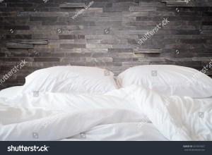 bed messy background sheets close bedding pillow concept stone natural wall shutterstock
