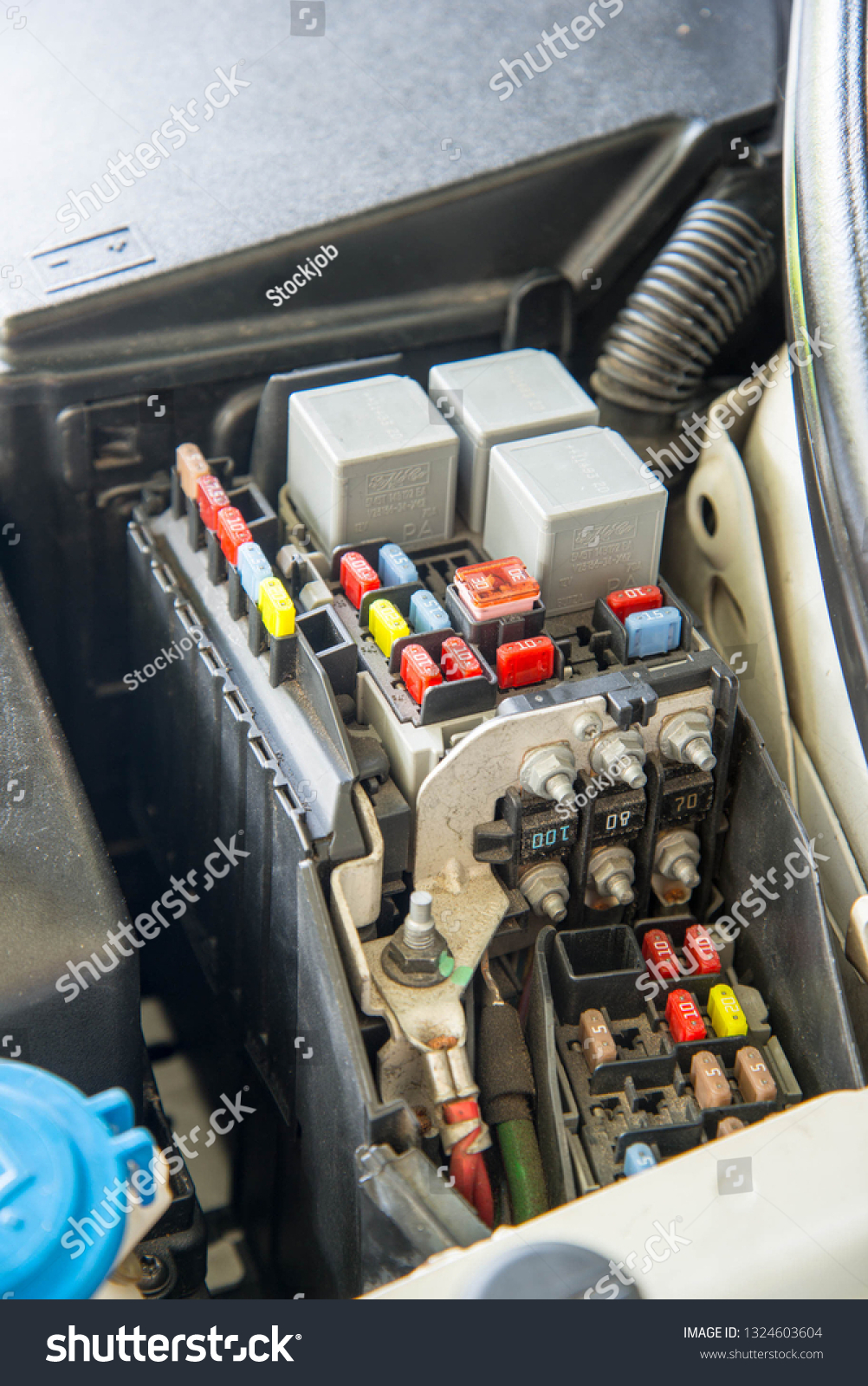 hight resolution of closed up car fuse box mini fuses and relays