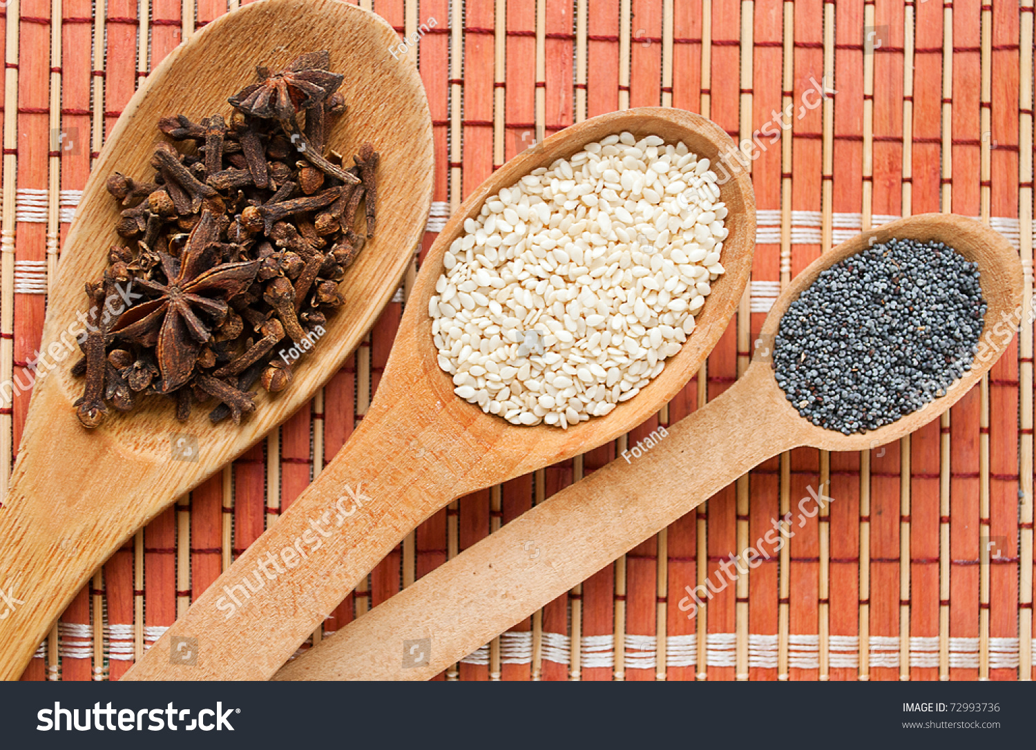 Cooking Spices In Wooden Spoons. Cloves, Sesame Seeds, Poppy Seeds. Stock Photo 72993736 : Shutterstock