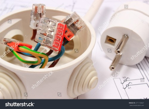 small resolution of copper wire connections in electrical box and electric plug lying on construction drawing of house