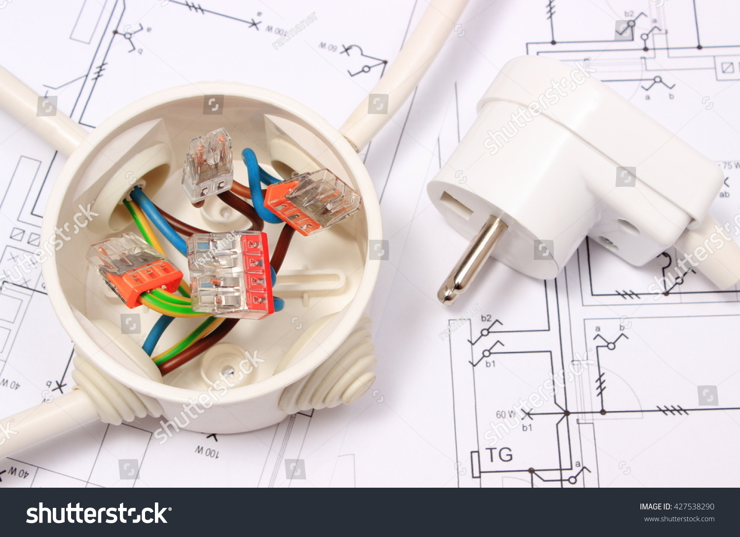 hight resolution of copper wire connections in electrical box and electric plug lying on construction drawing of house