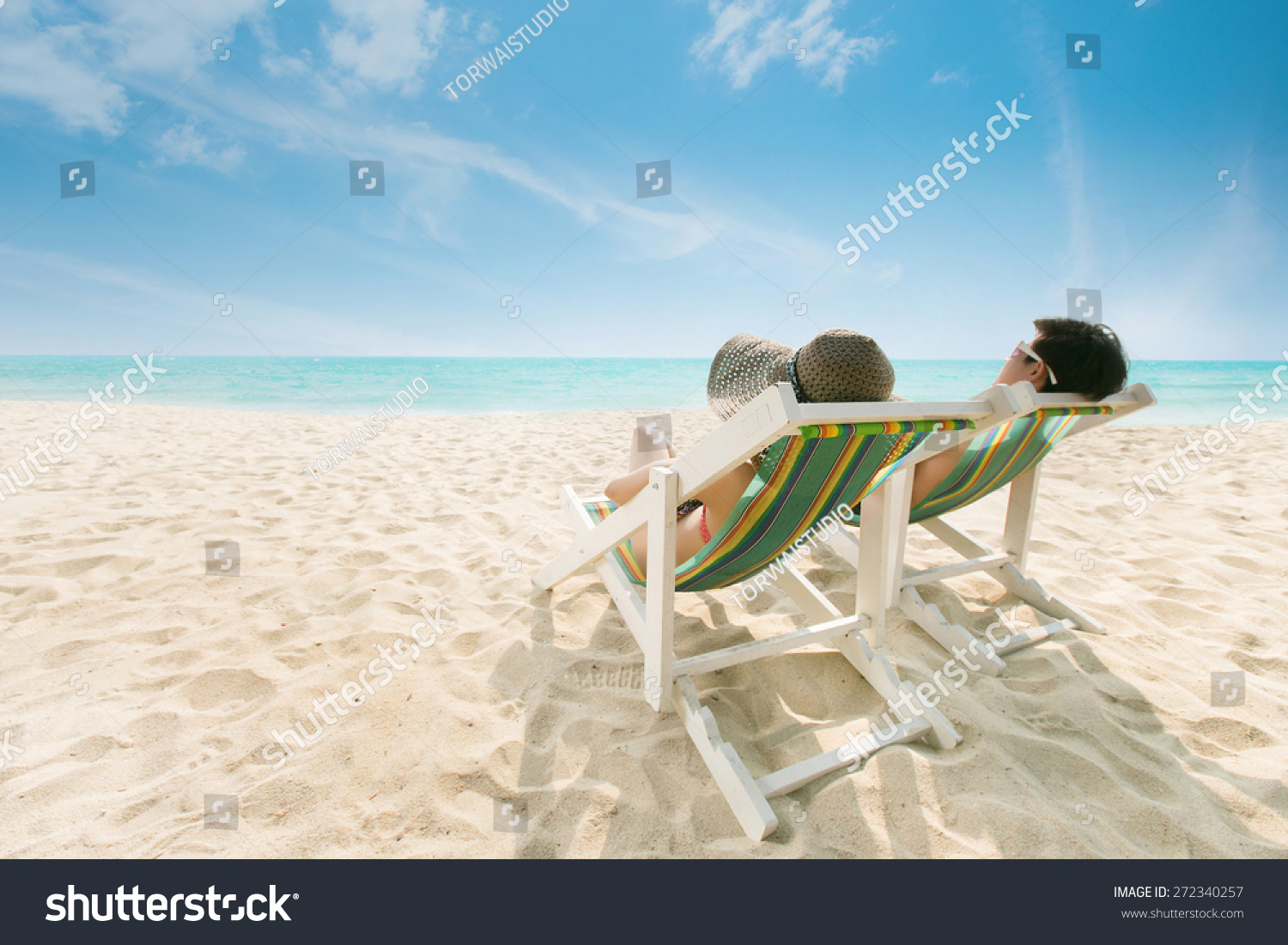 Sunbathing Chairs Couple Sunbathing On Beach Chair Beach Stock Photo