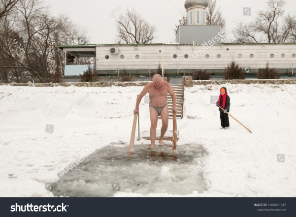 Galitsin Crazy elderly Russian man, swimming in the ice-hole as President Putin on Lake Seliger. Feast of the Baptism of Jesus Christ. Pyatimorsk, a baptismal ice-hole near the church of St. Innocent