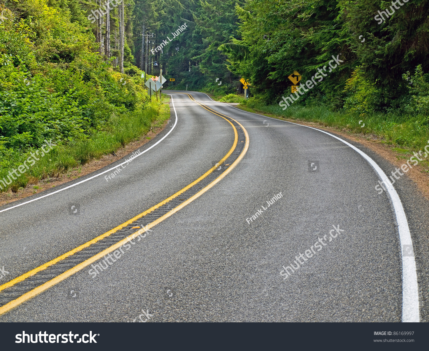 Curved Two Lane Country Road Winding Through A Forest Stock Photo 86169997 : Shutterstock