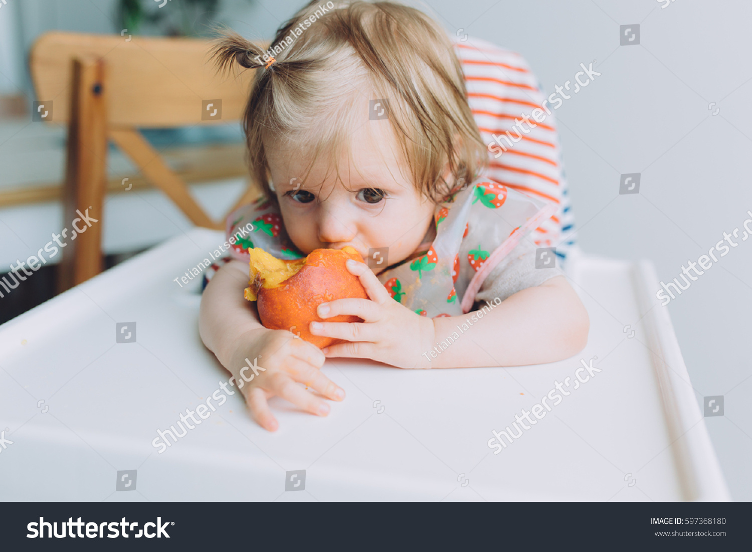 Cute Little Baby Smiling Eating Peach Stock Photo 597368180 - Shutterstock