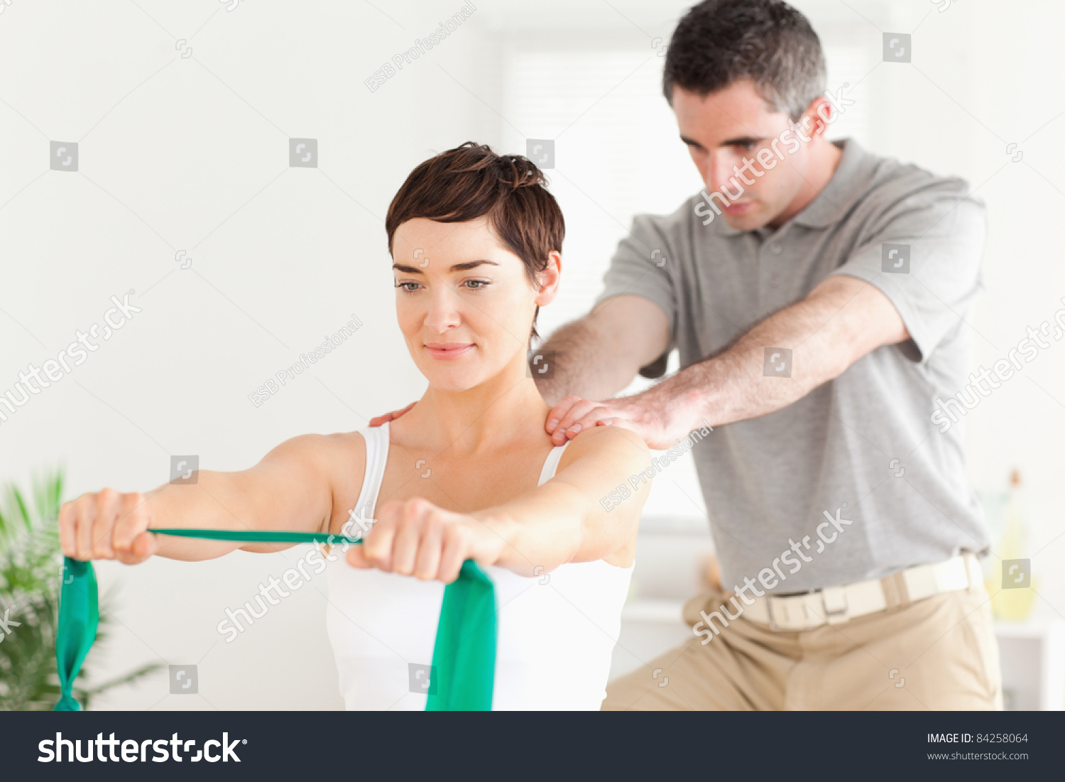 Cute Patient Doing Some Exercises Under Supervision In A Room Stock Photo 84258064 : Shutterstock