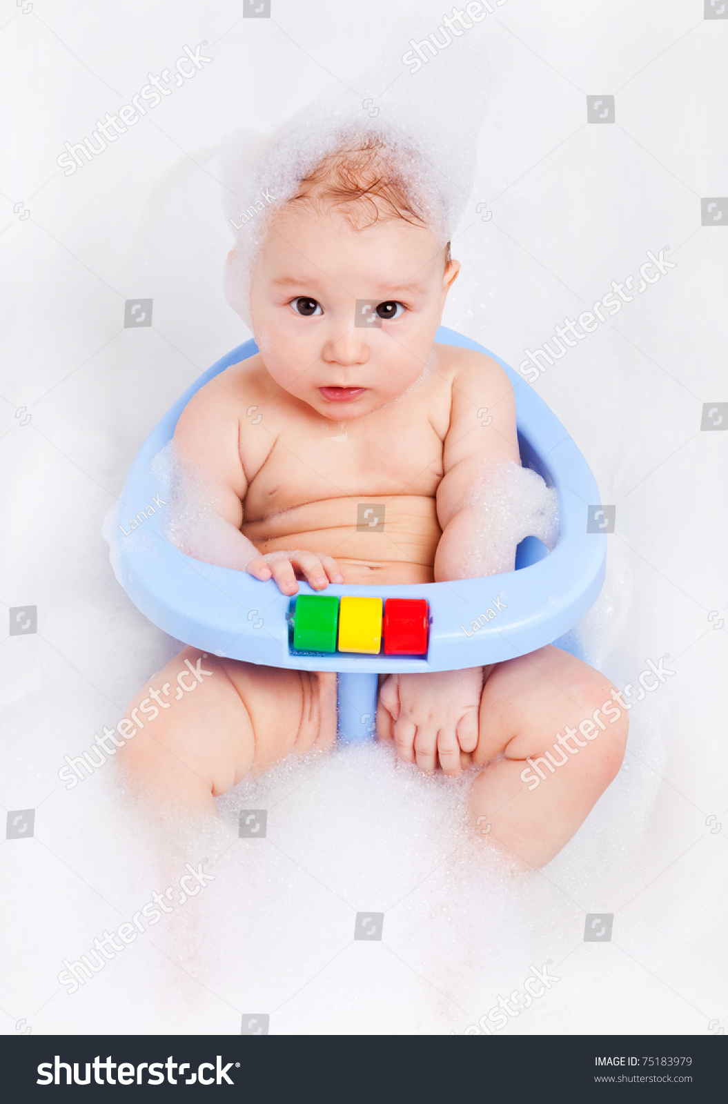 baby bather chair tufted armless cute six months old sitting in the bath