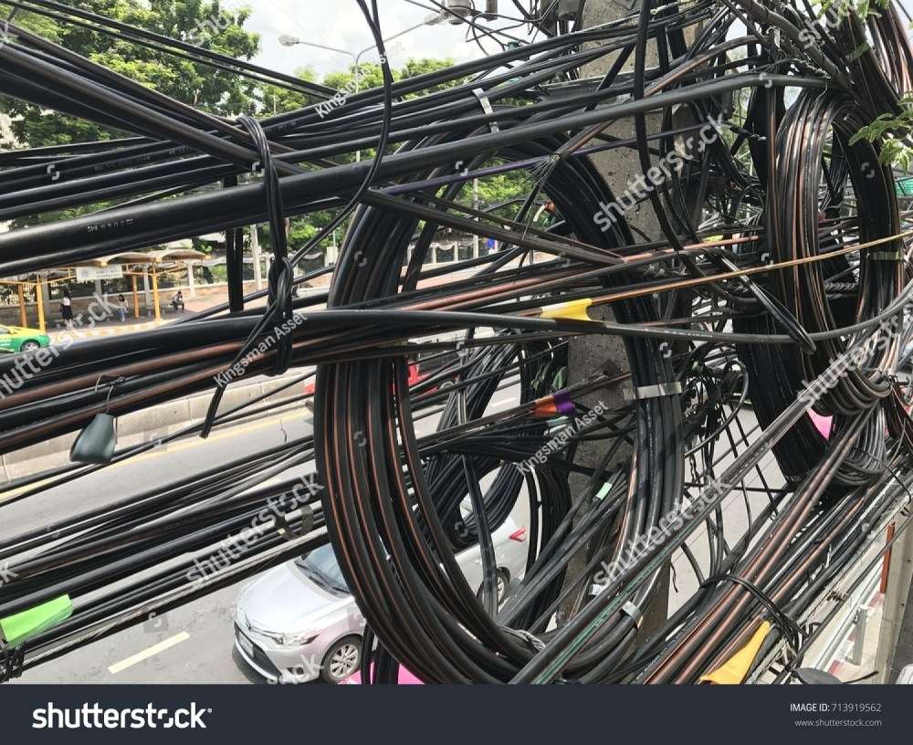 medium resolution of dangerous electrical wires on electric poles including high voltage power electrics phone communication cable