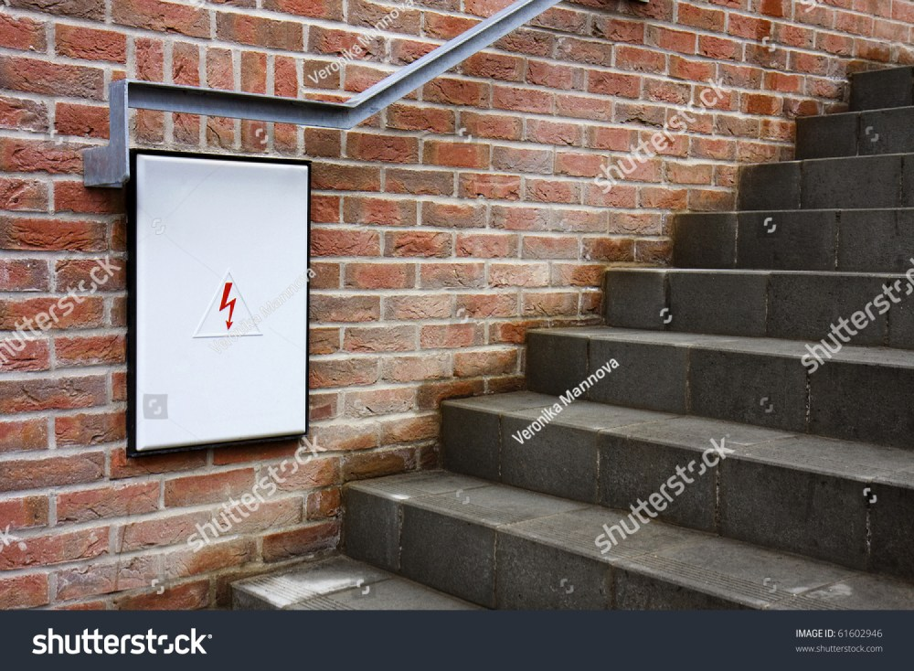 medium resolution of detail of a closed fuse box with white door under the stairs brick wall