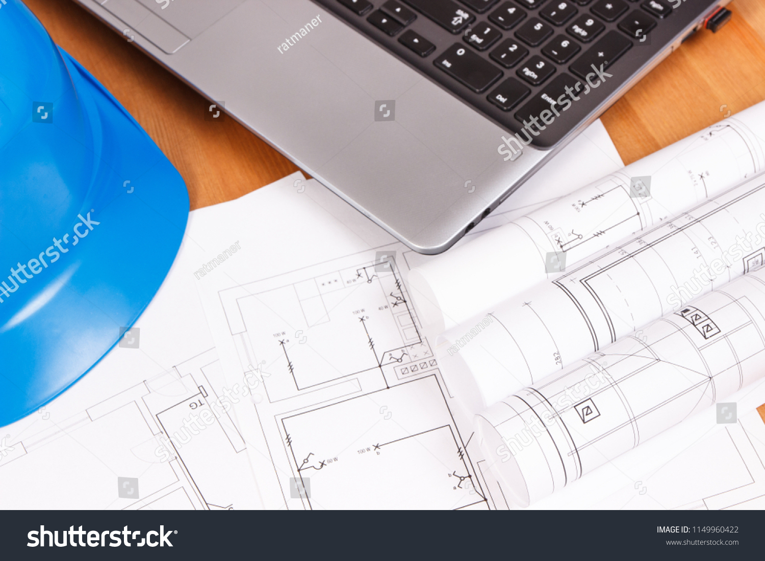 hight resolution of diagrams or electrical construction drawings with laptop and protective blue helmet for engineer jobs technology