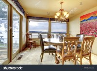Dining Room With Beige Walls, Art And Water View. Stock